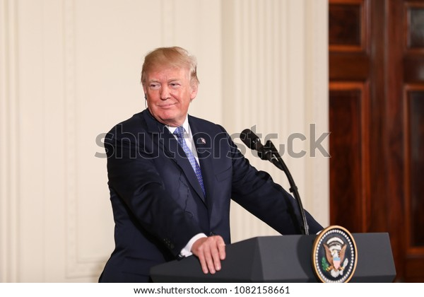 Washington, DC - April 27, 2018: US President Donald Trump speaks at a press conference in the East Room of the White House alongside German Chancellor Angela Merkel.