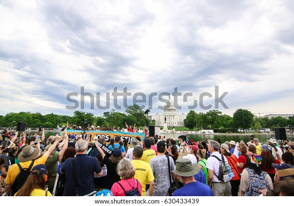 Washington, DC - April 29, 2017: Protesters attend the People's Climate March to stand up against climate change.