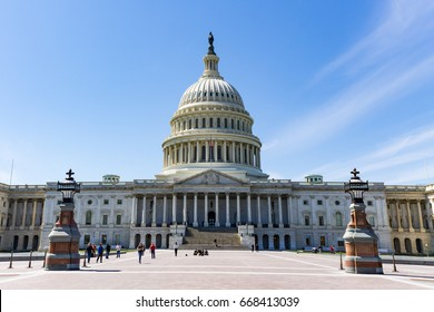 WASHINGTON, DC - APRIL 6, 2014:  People visit the East Front of the U.S. Capitol building.  The Capitol Building is the home of the U.S. Congress.