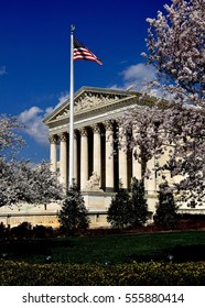 Washington, DC - April 9, 2014:  Cherry trees flank the majestic west front of the neo-classical 1935 United States Supreme Court