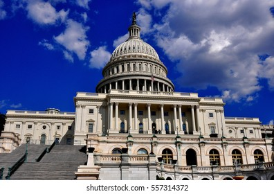 Washington, DC - April 9, 2014:  West front of the United States Capitol with its great staircase, center wing, and imposing dome *