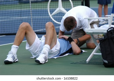 WASHINGTON, D.C. - AUGUST 12, 2008:  Marat Safin (RUS) is treated for during his match against Fabio Fognini (ITA) at the Legg Mason Tennis Classic.  Safin later withdrew due to a neck injury.