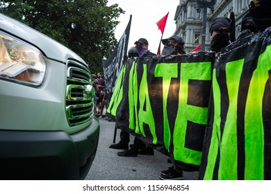 WASHINGTON, DC - AUGUST 12, 2018: Members of Black-Block on the anti-fascist counter-demonstration against the far right's Unite the Right 2 rally in the US capital.
