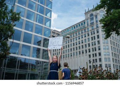 WASHINGTON, DC - AUGUST 12, 2018: The girl with a poster on the anti-fascist counter-demonstration against the far right's Unite the Right 2 rally in the US capital.