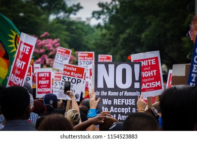 "WASHINGTON, DC - AUGUST 13, 2018: An activist in DC holds a protest sign that says ""No!"" at the Unite the Right 2 counter protest"
