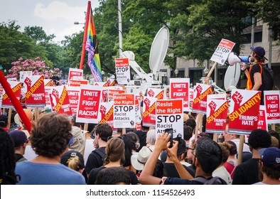 WASHINGTON, DC - AUGUST 13, 2018: A crowd of activists hold signs at the Unite the Right 2 counter protest in DC