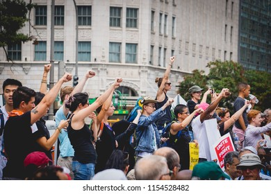 WASHINGTON, DC - AUGUST 13, 2018: Protestors raise their fists at the Unite the Right 2 counter protest in DC
