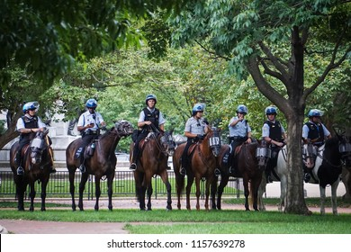 WASHINGTON, DC - AUGUST 13, 2018: Mounted police wait in the park at the Unite the Right 2 counter protest