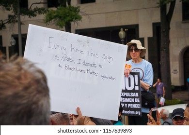 WASHINGTON, DC - AUGUST 13, 2018: An activist in DC holds a protest sign that says they donate to Black Lives Matter everytime it's stolen at the Unite the Right 2 counter protest