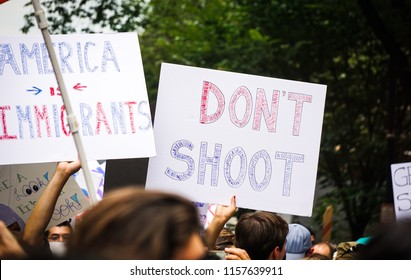 "WASHINGTON, DC - AUGUST 13, 2018: An activist in DC holds a protest sign that says ""Don't Shoot"" at the Unite the Right 2 counter protest"