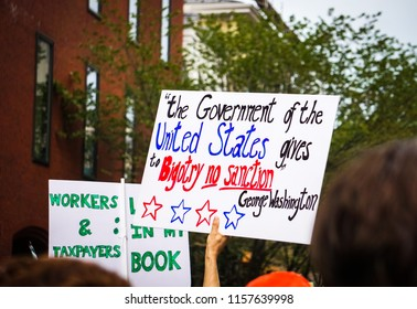 WASHINGTON, DC - AUGUST 13, 2018: A crowd of activists hold protest signs in the streets at the Unite the Right 2 counter protest