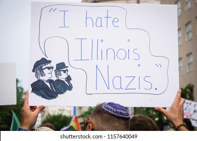 "WASHINGTON, DC - AUGUST 13, 2018: An activist in DC holds a protest sign that says ""I hate Illinois Nazis"" at the Unite the Right 2 counter protest"