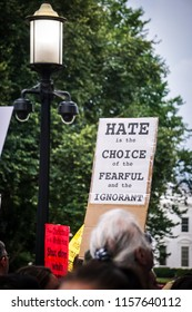 "WASHINGTON, DC - AUGUST 13, 2018: An activist in DC holds a protest sign that says ""Hate is the choice of the fearful"" at the Unite the Right 2 counter protest"
