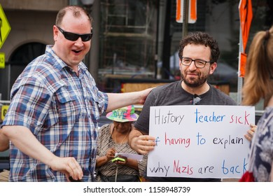 WASHINGTON, DC - AUGUST 13, 2018: A man is delighted by a history teacher protesting at the Unite the Right 2 counter protest