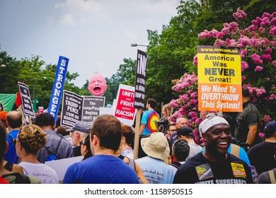 WASHINGTON, DC - AUGUST 13, 2018: A crowd of activists hold protest signs at the Unite the Right 2 counter protest
