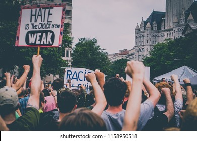 WASHINGTON, DC - AUGUST 13, 2018: The crowd of protestors raise their fists at the Unite the Right 2 counter protest