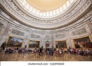 WASHINGTON, DC - AUGUST 19, 2017: Visitors listen to tour guides in the Great Rotunda of the United States Capitol.