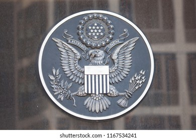 WASHINGTON, DC - AUGUST 20, 2017: The Great Seal of the United States above the entrance of the New Executive Office Building.