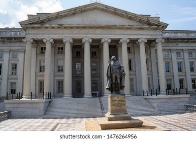 Washington, DC - August 4, 2019: Exterior of the United States Department of Treasury, with statue of Albert Gallatin, secretary of the treasury