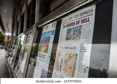 Washington, DC - August 5, 2019: Display of newspapers outside of the Newseum, a journalism museum. Newspapers show the headlines of recent mass shootings in El Paso and Dayton OH
