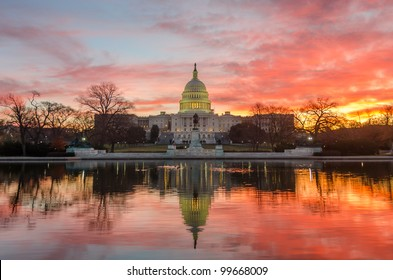 Washington DC, Capitol Building in a cloudy sunrise with mirror reflection