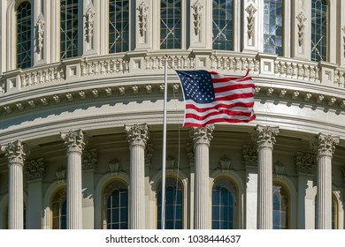 Washington DC Capitol detail with american flag in United States