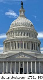Washington DC Capitol detail with waving american flag