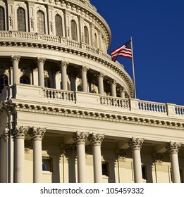 Washington DC ,Capitol, dome details with American Flag flapping, United States of America