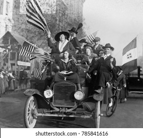 Washington, DC, celebration of the Armistice ending World War 1, Nov. 1918. An overloaded car of eleven happy men and women wave American flags