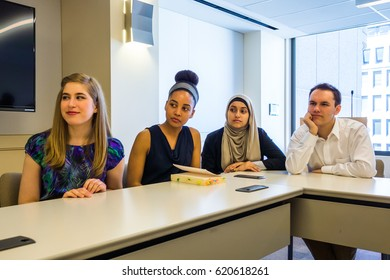 WASHINGTON DC - CIRCA APRIL 2015: Diverse, multicultural college students have a discussion in a lecture room at the Archer Center in Washington DC.
