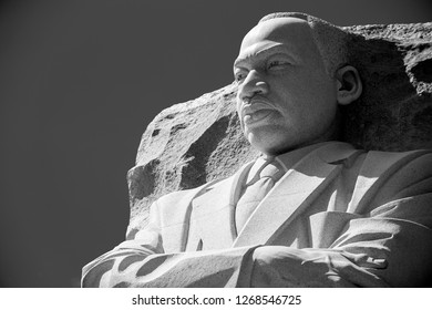 WASHINGTON DC - CIRCA AUGUST, 2018: The stone portrait statue at the Martin Luther King, Jr Memorial looks out under bright sunlight in solemn black and white.