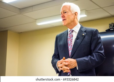 WASHINGTON DC - CIRCA JANUARY 2015: United States Senator John Cornyn (R-TX) talks to a group of students in a lecture hall in Washington DC.