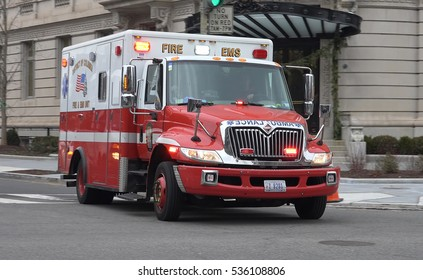 WASHINGTON, DC - DEC, 13, 2016: EMS Ambulance, responding through intersection.  EMS is part of DC Fire Department -- DC Fire & EMS, aka DCFEMS.
