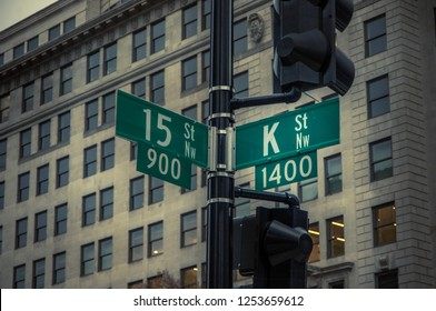 Washington DC, Dec 6, 2018; lamppost street signs mark intersection of 15th and K streets in nations capital.  K Street is famous as the home of many government lobbying and public relations companies