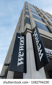 WASHINGTON, DC - DEC. 6, 2019: WeWork sign in front of one of WeWorks many office buildings.  WeWork rents office space for a variety of terms and configurations.