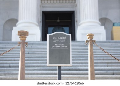 WASHINGTON, DC - DECEMBER 26, 2018: Sign for the Ceremonial Senate Door on the steps of the United States Capitol. The Senate left for recess despite the impending partial government shutdown.