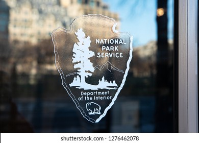 WASHINGTON, DC - DECEMBER 26, 2018: Logo for the National Park Service at the White House Visitor Center. Signs on other doors state it is closed due a lapse in federal appropriations.