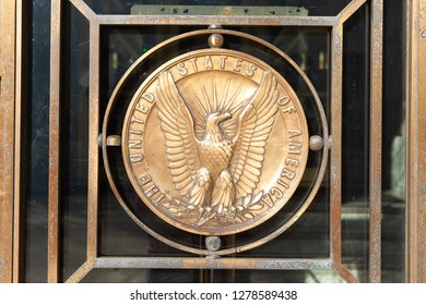 WASHINGTON, DC - DECEMBER 26, 2018: Bronze eagle medallion on an exterior door of the Dirksen Senate Office Building.  Days earlier the Senate recessed despite a looming partial government shutdown.
