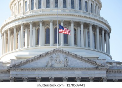 WASHINGTON, DC - DECEMBER 26, 2018: American flag flies at half-staff over the United States Capitol in honor of President George H.W. Bush who died on November 30, 2018.