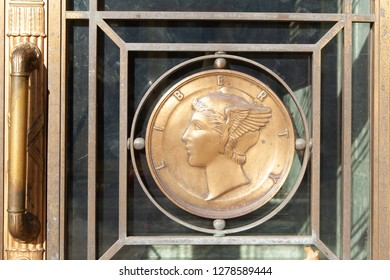 WASHINGTON, DC - DECEMBER 26, 2018: Bronze Liberty Head medallion on an exterior door of the Dirksen Senate Office Building. The Senate recessed just days before partial government shutdown.