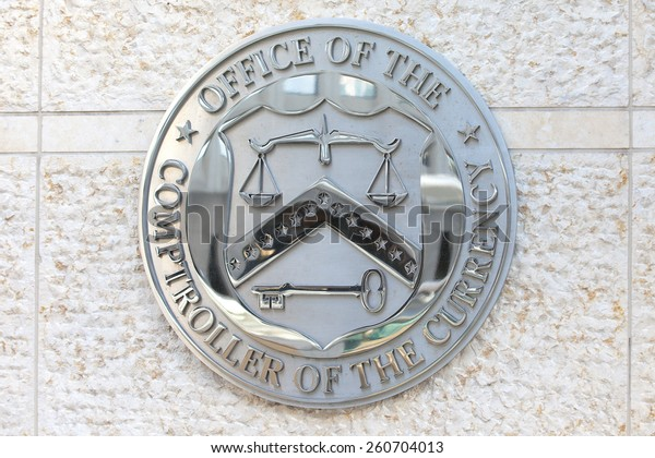 WASHINGTON, DC - DECEMBER 26: Seal of the Office of the Comptroller of the Currency in downtown Washington, DC on December 26, 2014.