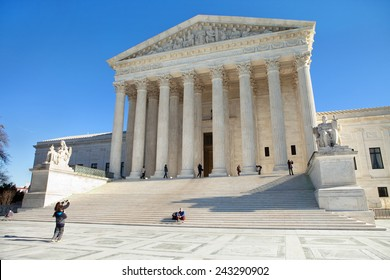 WASHINGTON, DC - DECEMBER 26: Tourists take photos of the Supreme Court Building in Washington, DC on December 26, 2014.