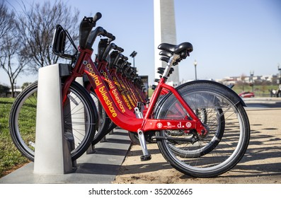 WASHINGTON DC. DECEMBER 4TH 2015. ROW OF BIKE FROM CAPITAL BIKESHARE RENTAL COMPANY ON THE WASHINGTON MONUMENT