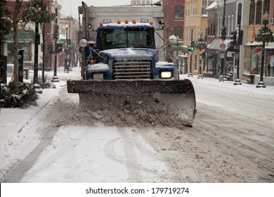 WASHINGTON, DC - FEBRUARY 3: Winter storm of the Mid Atlantic on February 3, 2014 in Washington, DC. Truck plowing Wisconsin Ave. in Georgetown. The government, stores and companies where closed.