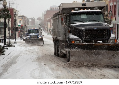 WASHINGTON, DC - FEBRUARY 3: Winter storm of the Mid Atlantic on February 3, 2014 in Washington, DC. Trucks plowing Wisconsin Ave. in Georgetown. The government, stores and companies where closed.