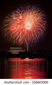 Washington DC fireworks over the Potomac River with view of Lincoln Memorial and Washington Monument