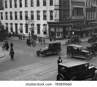 Washington, D.C. intersection with automobile traffic and pedestrians in 1924. Traffic signals were first installed in the mid-1910s, but have yet to arrive at this Washington, D.C. location