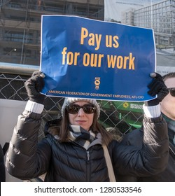 WASHINGTON, DC – JAN. 10, 2019: Protest of government shutdown by furloughed as well as unpaid working federal employees, union members, contractors and supporters at rally AFL-CIO.