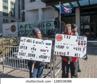 WASHINGTON, DC – JAN. 10, 2019: Protesting the partial government shutdown at rally at AFL-CIO headquarters, where union leaders and members of congress called on Trump & McConnell to end the shutdown