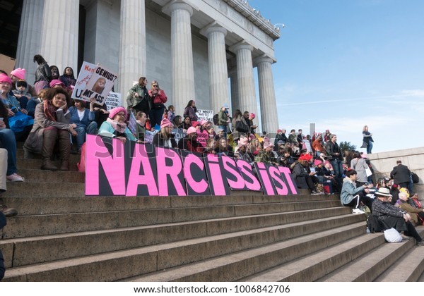WASHINGTON, DC - JAN. 20, 2018: On steps of Lincoln Memorial at 2018 Women's March on Washington, demonstrating against narcissist president Trump's administration and policies.